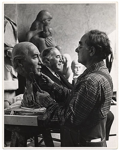 [William Zorach working on a portrait bust]