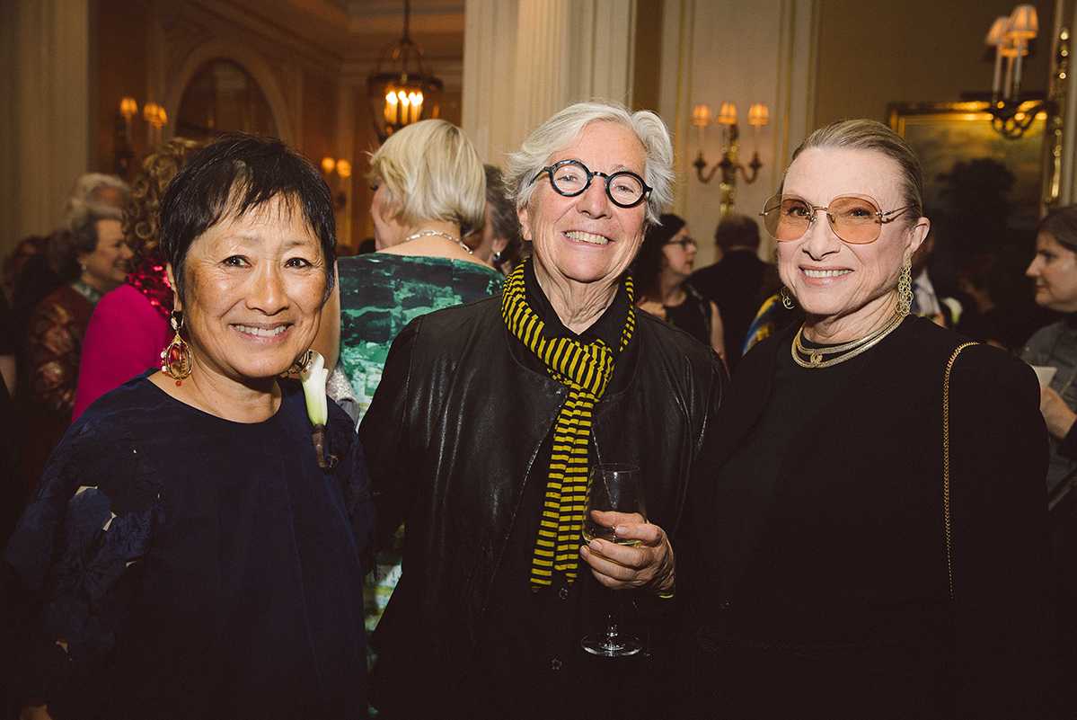 Billie Tsien, Judy Pfaff, and Susanne Emmerich pose for a photograph during cocktail hour.