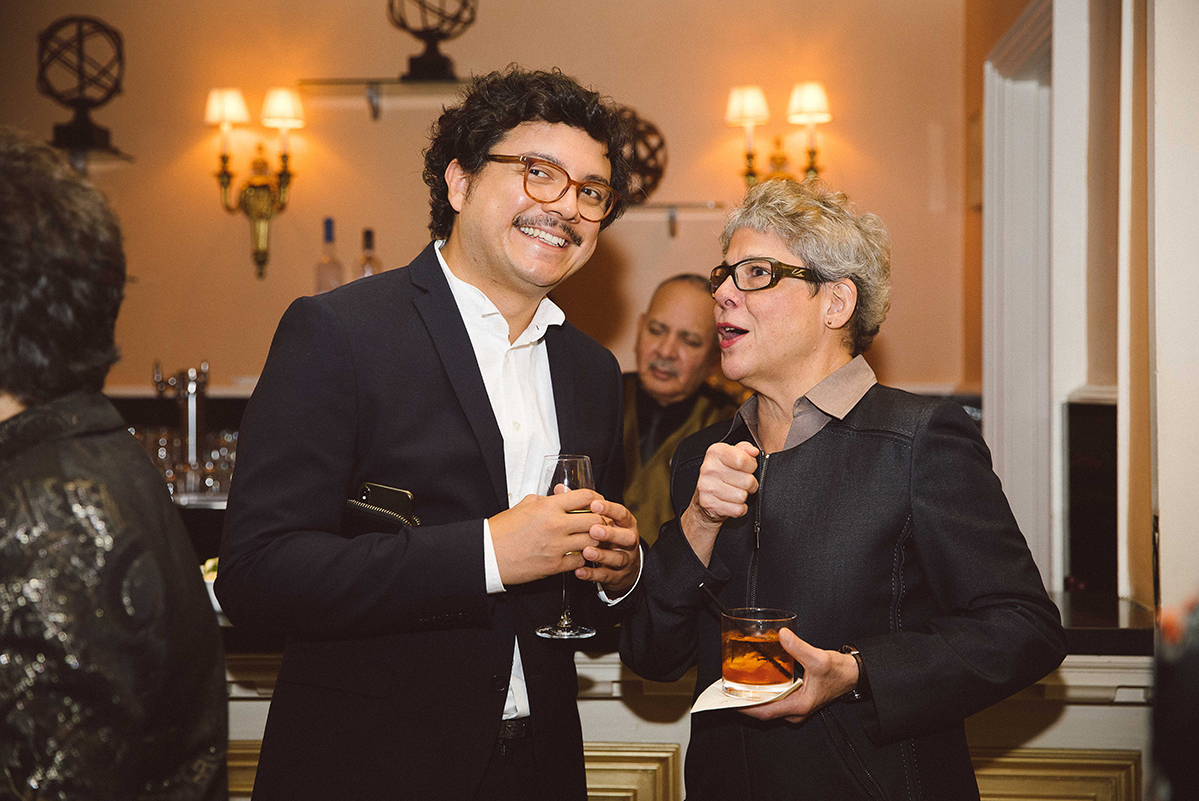 Josh Franco and María Elena González chat over cocktails at the 2019 gala.