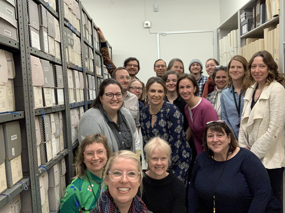 Photograph of the Archives' staff in our storage room