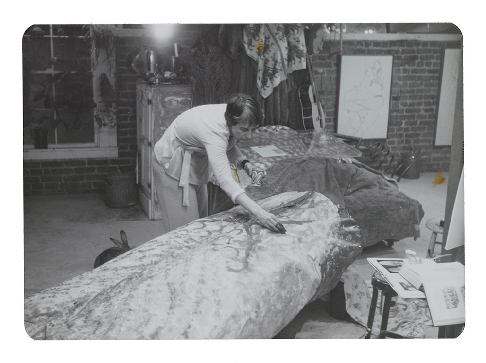 Image of Eleanor Dickinson painting her car for the Artists' Soap Box Derby