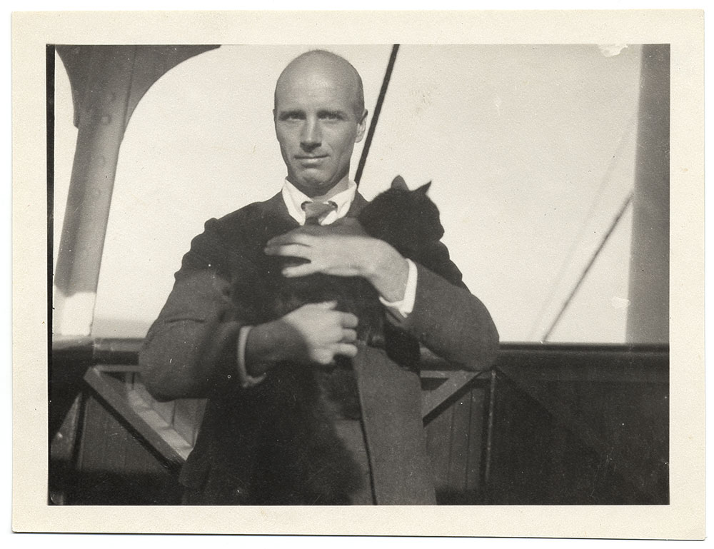 Photograph of Rockwell Kent holding a cat
