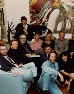 Louis and Susan Meisel in their loft with Photorealist artists at a party for Photorealism since 1980, 1993 Apr. 22