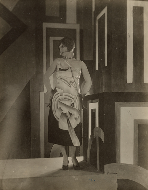 Photograph of Gilda Gray in a dress designed by Louis Lozowick