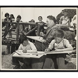 Black and white photograph of Chiura Obata teaching a children's art class at Tanforan Art School, August 1942