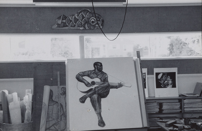 Photo of White's studio showing his painting The Guitarist