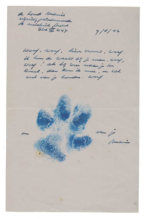 Letter with dog pawprint in ink.