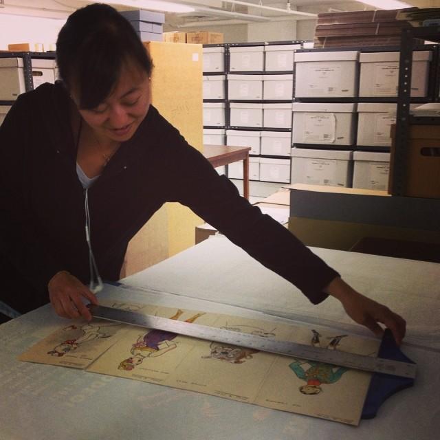Archivist measuring an illustration