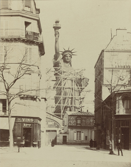 Photograph of the Statue of Liberty being constructed outside the studio of Frédéric Auguste Bartholdi taken by Alber Fernique