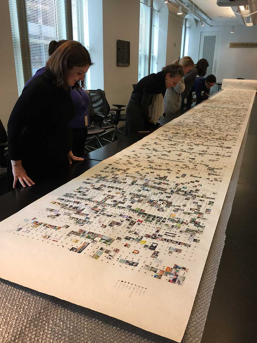 Staff of the Archives examine Long Scroll