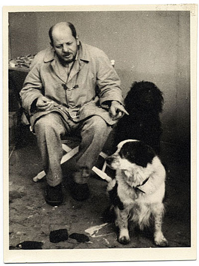 Photograph of Jackson Pollock with his dogs Gyp and Ahab