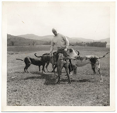 Photograph of Kent with a group of dogs