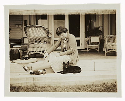 Weems seated with a dog