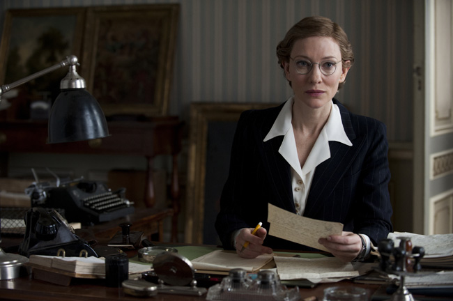 Jeu De Paume Claire's office - Paris, int. Claire (CATE BLANCHETT) listens in to a conversation from her desk in Columbia Pictures' THE MONUMENTS MEN. Photo By:	Claudette Barius Copyright: © 2014 Columbia TriStar Marketing Group, Inc. All RightsReserved. Used with permission.