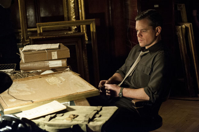 Jeu De Paume Granger's Rm - Paris, int. Granger (MATT DAMON) sits at a desk looking at paintings in Columbia Pictures' THE MONUMENTS MEN. Photo By: Claudette Barius Copyright: © 2014 Columbia TriStar Marketing Group, Inc. All RightsReserved.Used with permission.
