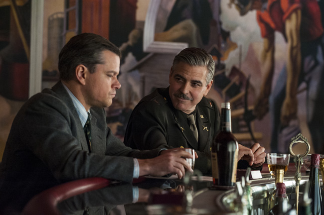 Matt Damon (left) and George Clooney in Columbia Pictures' THE MONUMENTS MEN. Photo By: Claudette Barius Copyright: © 2014 Columbia TriStar Marketing Group, Inc.. All Rights Reserved.Used with permission.