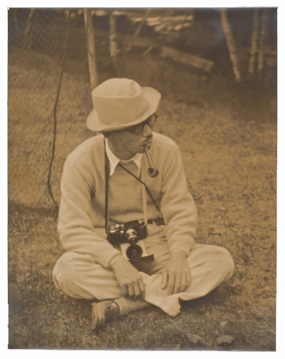 Photograph of Yasuo Kuniyoshi with a camera