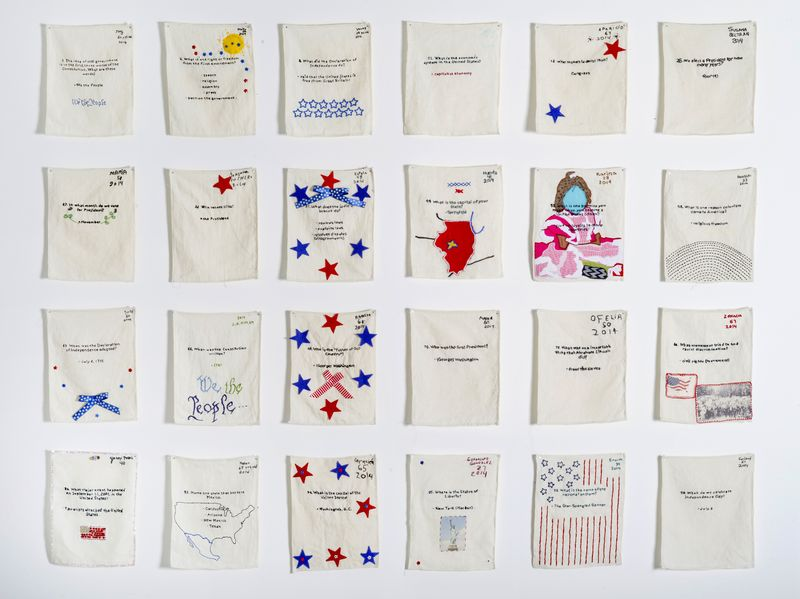 Collection of Samplers: Individual Question and Answers Sewn by Non-US Citizens Living and Working in the US (Oakland, San Francisco, San Diego, Modesto, Manteca, Millersville, Chicago), 53 x 66 x 1 inches, Cotton thread and fabric on linen, 2013-present. Photo: Hyounsang Yoo. Used with permission.