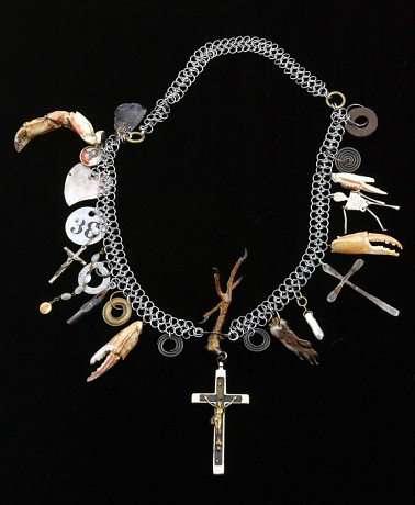 Artwork by Robert Ebendorf, Lost Soul, Found Spirit, 1996 mixed media: paint on metal, pearls, squirrel's foot, glass, crab claws, metal and wood crucifixes, metal fountain pen tip, chicken's foot, metal, ink on paper under plexi in metal, on a metal chain 13 x 12 x 1 ¼ inches Smithsonian American Art Museum Gift of the artist in memory of Mr. Ronald H. Pearson 1996.61. Used with permission.