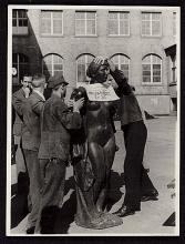 Six men prepare an Aristide Maillol sculpture looted during World War II for transport to France.