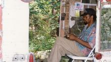 Photograph of Lonnie Holley at Howard Finster's Paradise Garden, Summerville, GA, 1992.