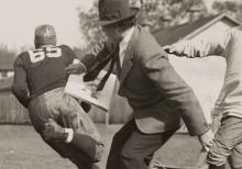 Detail of photograph of John Steuart Curry sketching during a football practice
