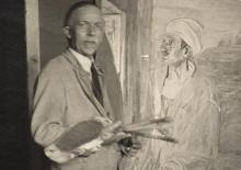 Henry Ossawa Tanner in his studio next to his painting, Judas.