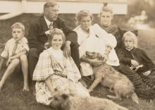 Edmund C. Tarbell and his family in front of their New Castle, New Hampshire home.