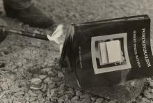 A copy of a book being burned with a blow torch.