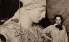 Photograph of the sculpture Pallas Athena with artist Enid Yandell