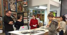 The authors examining  drawings by Dorothy Strum with Dr. Joe Lucchesi and Dr. Kelly Quinn at St. Mary's College of Maryland.