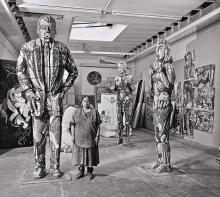 Viola Frey with monumental figures and paintings in her studio, Oakland, CA, 1987. Image courtesy of M. Lee Fatherree; artworks