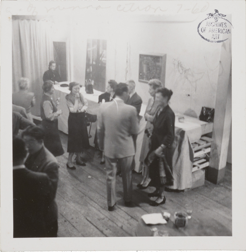 Figure 25. 14 Painter-Printmakers party, November 1954. Identifiable figures are: Seong Moy (lower left corner), Alice Trumbull Mason (at center, standing in front of chair), and Minna Citron (at far right). 14 Painter-Printmakers party, unidentified photographer. Minna Wright Citron papers, Archives of American Art, Smithsonian Institution.